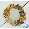Золотая брошь с раухтопазами, цитринами, кварцем и лунным камнем