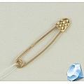 Золотая булавка для женщины